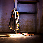 A baby sleeps in a hammock inside the factory whilst her parents work.. Image © Balaji Maheshwar/Falcon Photo Agency