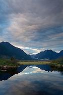 Pitt Polder Ecological Reserve's Pitt Marsh, Pitt River, and the Coast Range after sunset in Pitt Meadows, British Columbia, Canada