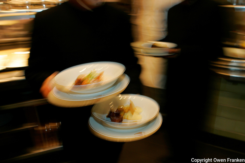 Waiters leaving the kitchen of Restaurant Daniel, of Chef Daniel Boulud, New York City - Photograph by Owen Franken