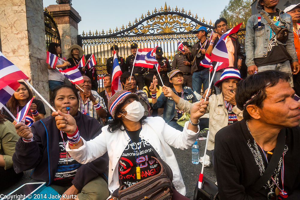 26 JANUARY 2014 - BANGKOK, THAILAND: Anti-government protestors block access to the polling place Bang Kapi School in the Bang Kapi district of Bangkok. The Anti-government protestors forced the closure of polling places in Bangkok Sunday as a part of Shutdown Bangkok. Early voting was supposed to be Sunday January 26 but blocked polling places left hundreds of thousands of people unable to vote casting the February 2 general election into doubt and further gridlocking Thai politics. Protestors blocked access to gates and entry ways to polling places and election officials chose the close them rather than confront protestors. Shutdown Bangkok has been going for 12 days with no resolution in sight. Suthep, the leader of the anti-government protests and the People's Democratic Reform Committee (PDRC), the umbrella organization of the protests,  is still demanding the caretaker government of Prime Minister Yingluck Shinawatra resign, the PM says she won't resign and intends to go ahead with the election.    PHOTO BY JACK KURTZ