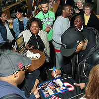 Philadelphia Sixers legend Allen Iverson signs a photo for a fan during a Delaware 87ers season ticket holders meet & greet Saturday, Apr. 05, 2014 at Buffalo wild wings in Wilmington, DEL.