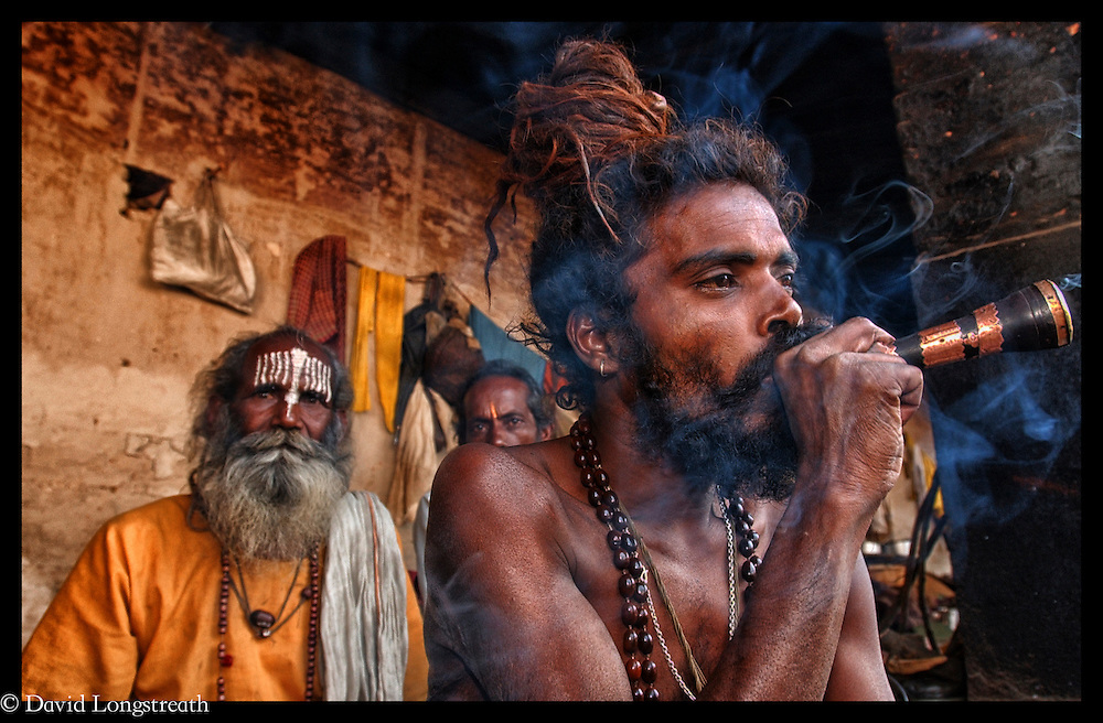 A trio of Sadhu's smoke at a shrine in Katmandu, Nepal.  In Hinduism, sadhu is an ascetic wandering monk.  According to, Wikipdeia,  the sadhu is dedicated to achieving liberation and the final stage of life through meditation and contemplation of brahman.  Sadhus have left behind all material and sexual attachments.  There are 4 to 5 million living in India today..
