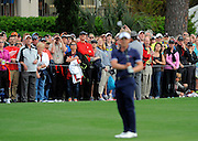 The crowd reacts after Luke Donald, of England, misses a putt for birdie on the 18th green during the final round of the RBC Heritage golf tournament in Hilton Head Island, S.C., Sunday, April 20, 2014. Matt Kuchar won the tournament with 11-under par. (AP Photo/Stephen B. Morton)