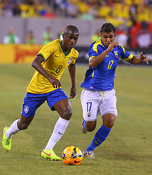Sep 9, 2014; East Rutherford, NJ, USA; Brazil midfielder Ramires (8) runs with the ball past Ecuador forward Junior Sornoza (17) during the first half at MetLife Stadium.
