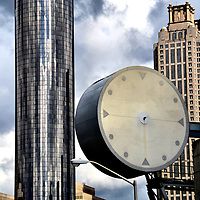 Westin Peachtree Plaza and Street Clock in Atlanta, Georgia<br /> When it opened in 1976, The Westin Peachtree Plaza was not only the tallest building in Atlanta but also the tallest hotel in the world at 73 stories. Although it lost both distinctions, it still is an impressive glass cylinder. On the right is 191 Peachtree Tower. Within a short distance of this clock are the headquarters of CNN, Coca Cola, UPS, AT&amp;T, Delta, Rubbermaid and Home Depot.