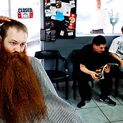 Jack Passion, 25, elicits stares at his local barber shop as he gets a trim in preparation for the 2009 World Beard and Moustache Championships in Anchorage, Alaska. No stranger to the arena of competitive facial hair-growing, Passion and his follicular flair won first place in the full beard: natural category at the 2007 championship in Brighton, England. He has since incorporated, launching a line of organic cotton T-shirts silk-screened with the likeness of his beard and self-publishing a how-to book entitled The Facial Hair Handbook. &quot;Everywhere I go, it starts conversations,&quot; Passion says of his six-year-old beard. &quot;I've gotten a lot of perspective on what it feels like to be looked at all the time.&quot;<br />