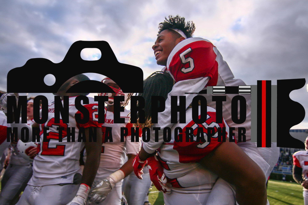 Smyrna (12-0) players Ty-Kee	Moore (55) and Emon	Roberts (5) celebrate after winning their second straight DIAA division one Football Championship defeating Top-seeded Middletown (11-1) 36-14 Saturday, Dec. 03, 2016 at Delaware Stadium in Newark.