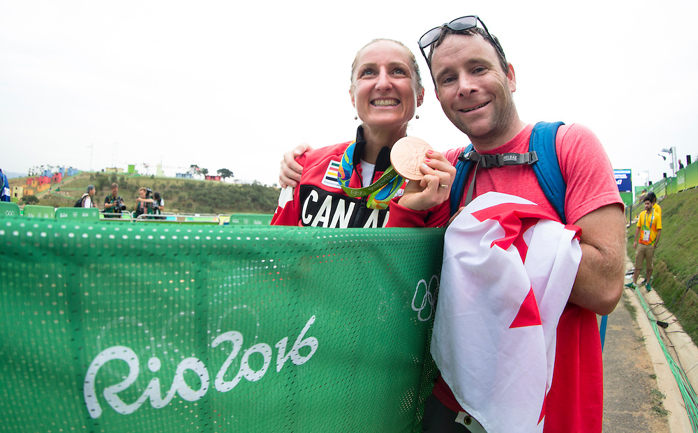 Catharine Pendrel hugs her husband Keith Wilson following winning the Bronze medal in the Mountain Bike competition at the Rio Olympics on August 20, 2016.
