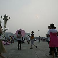 BEIJING, JULY-27  : Beijingers enjoy themselves in Tiananmen Square despite a hazy day.