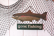 gone fishing sign and net