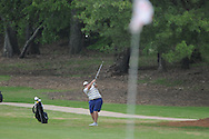 Oxford High's Turner Arnold hits a shot on the 4th hole during the opening round of the MHSAA Class 5A state championship golf tournament at the Ole Miss Golf Course in Oxford, Miss. on Wednesday, May 1, 2013.