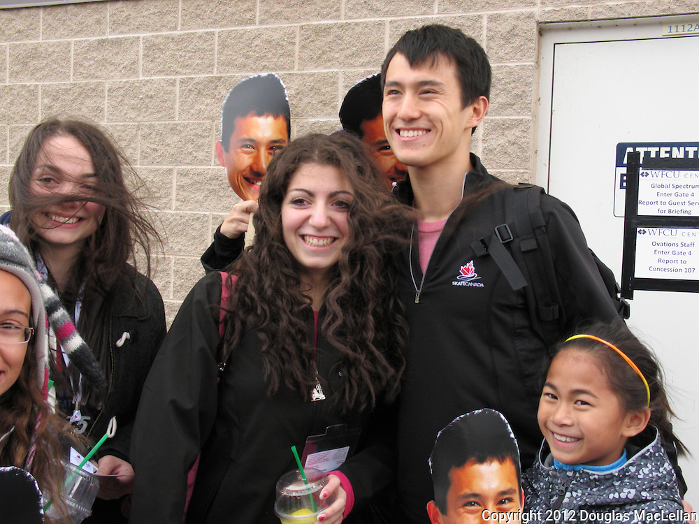 Patrick Chan poses with fans and 'Patrick Chan' cut out faces at the end of the 2012 Skate Canada International at WFCU Centre, Windsor, Ontario.