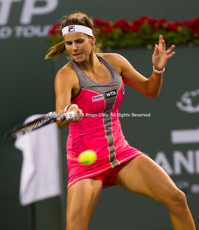 Julia Goerges, of Germany, returns a shot against Maria Sharapova, of Russia, during a second -round match at the BNP Paribas Open tennis tournament on Saturday, March 8, 2014, in Indian Wells, California.<br />  (Photo by Ringo Chiu/PHOTOFORMULA.com)