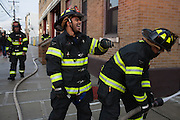 Probationary fire fighters and veterans Victor Ramos, center, and Andres Godoy, right, joke during training watched by probationary fire fighter and veteran AJ Maresca, left, at the 16th Street Fire House of the North Hudson Regional Fire and Rescue in Union City, NJ on November 07, 2013. Many vets say after the military they're still looking for a career with a sense of public service. Some vets have found that at the North Hudson Regional Fire and Rescue in New Jersey.