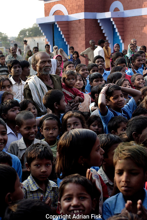 As the sun goes down at the Purvaiachal dalit Balika school in ghazipur district, dalit children watch dance and singing preformances by school children.