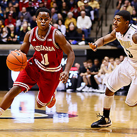 WEST LAFAYETTE, IN - JANUARY 30: Kevin Ferrell #11 of the Indiana Hoosiers dribbles the ball against Ronnie Johnson #3 of the Purdue Boilermakers at Mackey Arena on January 30, 2013 in West Lafayette, Indiana. Indiana defeated Purdue 97-60. (Photo by Michael Hickey/Getty Images) *** Local Caption *** Kevin Ferrell; Ronnie Johnson