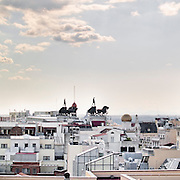 Sculptures of chariots on the roofs of Madrid, Spain