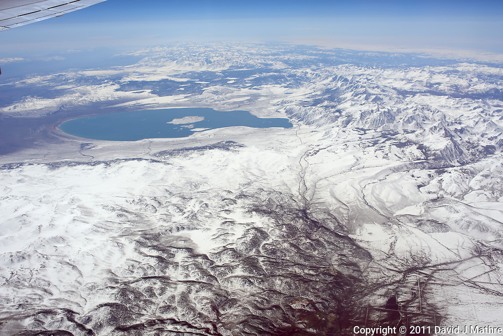 Aerial View of Mono Lake from 36,000 feet and 27 miles during a commercial flight from San Francisco to Newark. Image acquired with a Leica X1 (ISO 100, 24 mm, f/6.3, 1/1000 sec). Processed: Capture One 6 Pro (raw conversion, haze reduction), Photoshop CS5, Focus Magic (sharpening), Nik Define 2 (noise reduction), Photoshop CS5 (save for web).