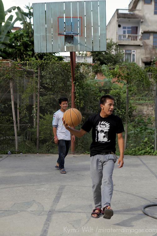 Asia, Nepal, Kathmandu. Nepali teens play basketball.