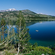 June Lake is a subalpine lake in Mono County, California, located at an elevation of 7,621 ft its pure water results in it having a deep blue color and submerged rocks to be seen near the shore.