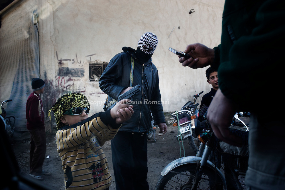 SYRIA - Homs province: This picture shows a child as he is playing with a toy gun  on February 20, 2012. ALESSIO ROMENZI
