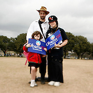Brett Finch(L) and his wife Umi Chandler-Finch(R) attend a rally held for U.S. Senator Barack Obama with their daughter Narayana Finch(6)in Austin, Texas, February 23, 2007.