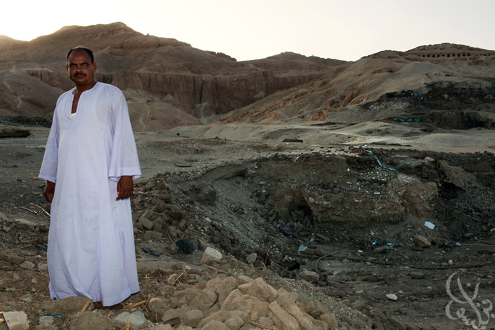 Ahmed al-Tayeb, a part time antiquities restoration worker, poses for a portrait June 6, 2009 at the site where his family home once stood before being recently razed by Egyptian authorities. Al-Tayeb is one of thousands of Egyptians displaced forcibly by Egyptian authorities as part of a 30 year, 5 Egyptian pound redevelopment plan in Luxor and the surrounding area..(Photo by Scott Nelson, for the Times)