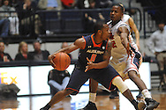 "Auburn guard Josh Wallace (11) vs. Ole Miss' Jarvis Summers (32) at the C.M. ""Tad"" Smith Coliseum on Saturday, February 23, 2013.  (AP Photo/Oxford Eagle, Bruce Newman)"