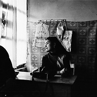 .HOTAN,2 OCOTBER 2001: a young doctor waits for patients inside her tiny hospital in Hotan. Most Uighur women do not attend university,and this doctor is a rare exception..Uighur muslims in southern Xinjiang province lead very basic lifestyles and have an average monthly income of about 50 US$.. . .  . .