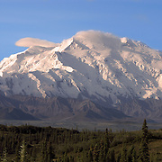 Mount McKinley, also known as Denali, is the highest point in North America at 20,320 feet (6,197.6 meters) located in the Alaska Range of Southcentral Alaska, USA, North America. The peak was first scaled in 1913.