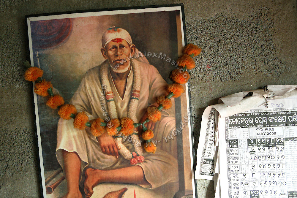 A picture of Shri Sai Baba, a famous Indian Guru, is seen on the wall of Budhia Singh?s house situated inside Salia Sahi slum (pop. 30.000) of Bhubaneswar, the capital of Orissa State, on Saturday, May 17, 2008. On May 1, 2006, Budhia completed a record breaking 65 km run from Jagannath temple, Puri to Bhubaneswar. He was accompanied by his coach Biranchi Das and by the Central Reserve Police Force (CRPF). On 8th May 2006, a Government statement had ordered that he stopped running. The announcement came after doctors found the boy had high blood pressure and cardiological stress. As of 13th August 2007 Budhia's coach Biranchi Das was arrested by Indian police on suspicion of torture. Singh has accused his coach of beating him and withholding food. Das says Singh's family are making up charges as a result of a few petty rows. On April 13, Biranchi Das was shot dead in Bhubaneswar, in what is believed to be an event unconnected with Budhia, although the police is investigating the case and has made an arrest, a local goon named Raja Archary, which is now in police custody. **Italy and China Out**