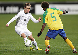New Zealand's Michael McGlinchey is challenged by Solomon Islands' Freddie Kini in a FIFA World Cup Qualifier Match, North Harbour Stadium, Auckland, New Zealand, Tuesday, September 11, 2012.  Credit:SNPA / David Rowland