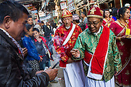 Buddhist priests take incense sticks as they process through the streets of Patan as part of a religious festival. The old city is home to the Newar community, who are the original inhabitants of the Kathmandu Valley and practitioners of an ancient form of Buddhism that contains many elements of Hindusim.