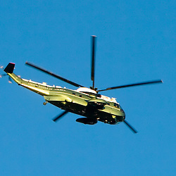 Making practice runs for Barack Obama's first visit back to Chicago, the presidential helicopter flies over the city.
