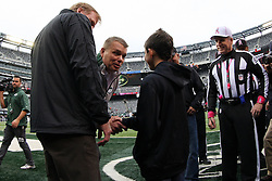 Oct 28, 2012; East Rutherford, NJ, USA; NFL commissioner Roger Goodell (l) and former New York Jet Joe Klecko greet 11 year old Dante Cano before the game between the New York Jets and the Miami Dolphins at MetLIfe Stadium.