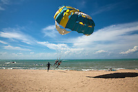 Parasailing at Batu Ferringhi which has some of the nicest beaches on Penang Island. The long stretch of beach is a combination of wide golden-sand beaches and picturesque deep blue-green coves surrounded by large granite boulders that tumbled from the hilly interiors of the island, right into the sea.  Some locals believe that the word Ferringhi was derived from Portuguese which means 'foreigners rock'.