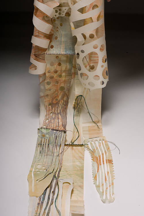 Artist: Kathyrn Petke. Shapes cut from prints bound in fold out book.