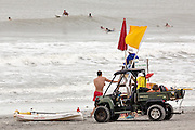 Lifeguards watch surfers as Hurricane Arthur passing off shore brought high surf and rip tides to the beaches along the South Carolina coast July 3, 2014 in Folly Beach, SC. The first hurricane of the season passed far off the South Carolina coast causing no damage and little rain.