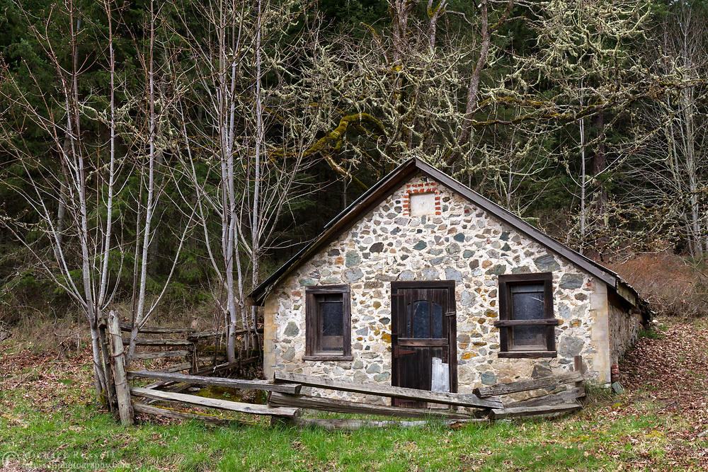 The root cellar built by Richard Maxwellon his farm in 1901.  This root cellar is one of the historic farm buildings in Burgoyne Bay Provincial Park on Salt Spring Island, British Columbia, Canada. Photographed from Burgoyne Bay Road.