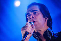 Frontman Nick Cave, of Nick Cave and the Bad Seeds, under the spotlight, on stage tonight at The Barrowlands, Glasgow, Scotland.<br /> &copy;Michael Schofield.