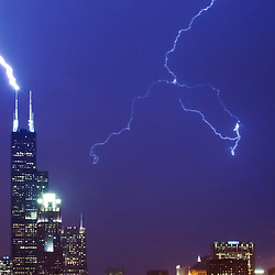 Lightning strikes the antenna of the Sears (now Willis) Tower in Chicago, IL.