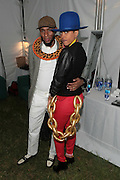 August 25, 2012-Brooklyn, NY: (L-R) Recording Artist Yasiin Bey aka Mos Def and Recording Artist Erykah Badu backstage at the Afropunk Festival 2012 held in Brooklyn, NY on August 25, 2012. The Afropunk Festival has become a Brooklyn intuition, the focal point for the burgeoning Afro-punk movement. Over the past seven years, the festival has presented new artists before they hit it big, such as Grammy-nominated Santigold, The Noisettes and Janelle Monae. Afro-punk mainstays like Saul Williams, The Dirtbombs, and Dallas Austin have also graced Afro-punk's stages. (Terrence Jennings/TerrenceJennings.com)