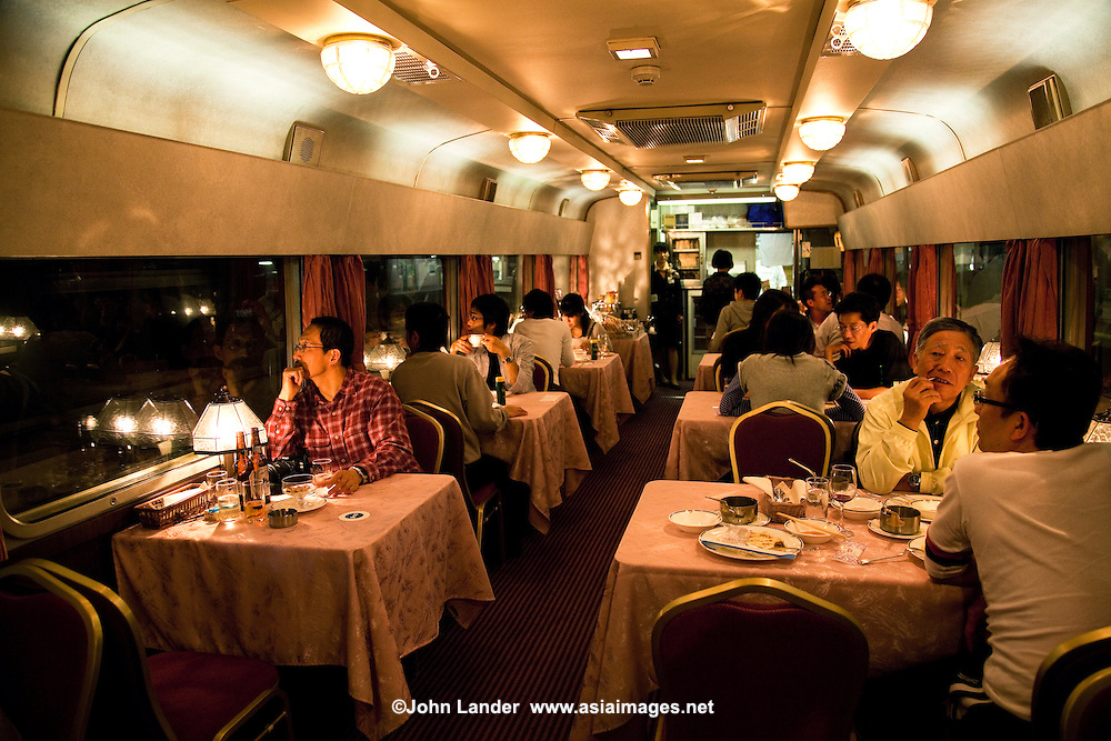 Dining Car On Board the Hokotosei or the North Star night train, plies its way nightly from Ueno Station in Tokyo to Sapporo.   The train takes approximately 16 hours in either direction Ueno-Sapporo.  Blue Trains in Japan are long-distance sleeper trains, nicknamed for the color of the train cars. They consist of sleeper cars, and currently run on nine routes connecting major destinations within Japan across long distances, other routes being served by a fleet of newer limited-express sleeper trains which are not blue.