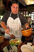 Learning to cook Thai food at the Four Seasons Resort cooking class in Chiang Mai, Thailand.
