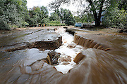 BOULDER, CO - SEPTEMBER 13: Topaz Street in Boulder, Colorado was washed away in large sections as heavy rains for the better part of week fueled widespread flooding in numerous Colorado towns on September 13, 2013. Local residents said the Four Mile Canyon Creek that runs nearby is usually a trickle at this time of year. (Photo by Marc Piscotty/ © 2013)
