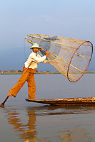 The ethnic Intha people who live around Inle Lake get around by using traditional skiffs propelled by a single paddle.  The curious Intha method of leg rowing - one leg wrapped around the paddle which drives the blade through the water.  The Intha make up the bulk of the fishermen on the lake.