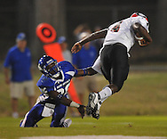 Water Valley's C.J. Jackson (26) makes a tackle vs. Coffeeville in Water Valley, Miss. on Friday, August 26, 2011.