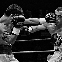 19 November 2009: Fight between Kemal Plavci (left) and Redouane Asloum (right) during the Grand Tournoi boxing semi finals event at Cirque d'Hiver in Paris, France.