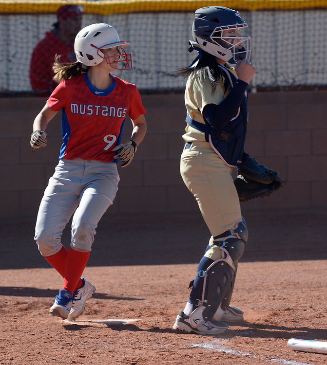 gbs040417j/SPORTS -- West Mesa's Luna Simoni, 9, scores while Atrisco Heritage catcher Jaelynn Vialpando watches for the throw in the first inning of the game at West Mesa on Tuesday, April 4, 2017. (Greg Sorber/Albuquerque Journal)
