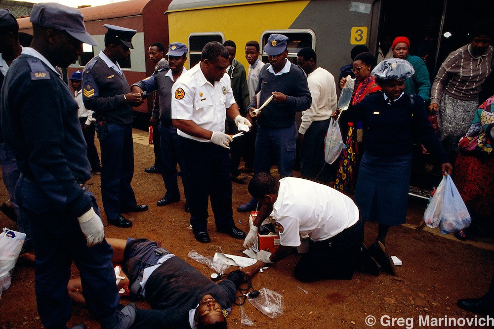 Soweto South Africa 1994. A wounded man is attended to by medics after being shot in a train, 1994.